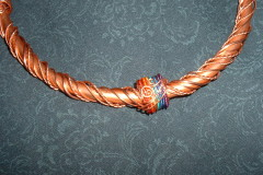 Copper tube choker with twisted copper wire wraparounds in various gauges, anodized colored copper rainbow accent band.