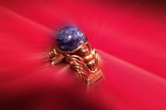Copper wire-sculpted ring with fossil bead ...